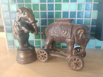 Two Antique  Vintage Cast Iron Elephant on Wheels Coin Bank