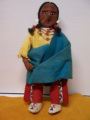 Native American doll with leather face and  hands, beaded leggings, bag and mocs
