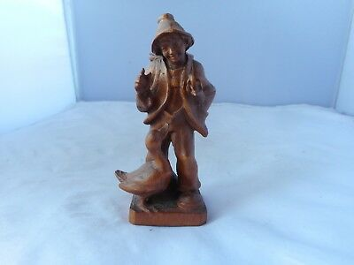 CARVED TREEN FIGURINE(9.25cms high)OF YOUNG BOY WITH A GOOSE