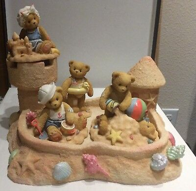 By the sea sand castle and set of 4 Cherished Teddies Beach Figures