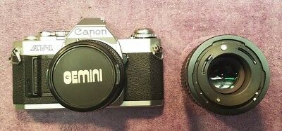 Cannon Av-1 Camera With Super Paragon 1:28 Lens And Bonus Sears Lens / Used