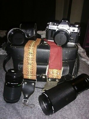 AE-1cannon camera with origional case and foyr lenses