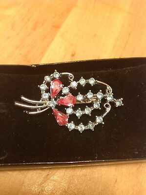 Beautiful vintage silver tone brooch with pink and blue crystals
