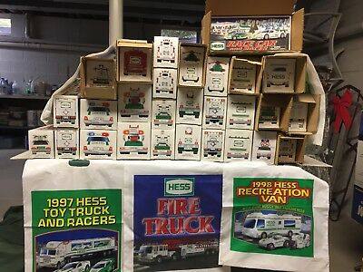hess toy truck lot. all trucks never used , boxes were opened to remove batterys
