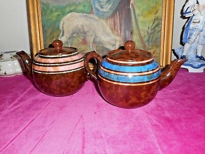 Two vintage pottery teapots