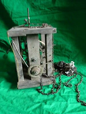 Antique wooden clock movement with chains
