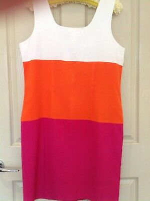 Vintage dress in white,orange and pink stripes size. 8 to 10