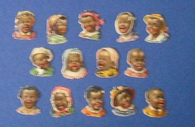 14 Victorian Die Cut Relief Scraps Negro Baby's heads, laughing and crying.