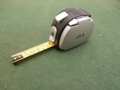 Sixteen Foot Tape with Light & Calculator. Unused. Stamped with 'JRA' initials.