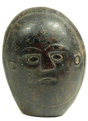 Old protective stone mask - West Timor, Indonesia