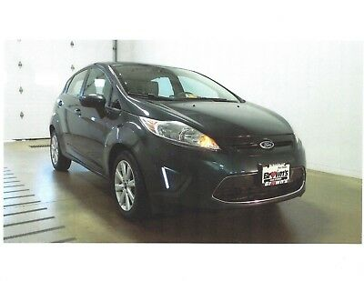 2011 Ford Fiesta Hatchback four door 2011 FORD FIESTA SE, Power sunroof, USB output …… Automatic