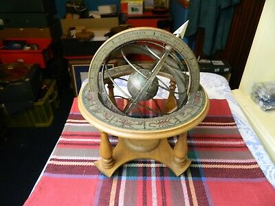 modern wooden armillary sphere on a concave platform on tapered legs