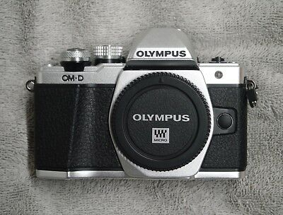 Olympus OM-D  E-M10 Mark II Silver Body with Extras.  Perfect Condition.