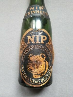Old Guinness Foreign Extra Stout Dog's Head Nip Bottle
