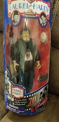numbered Laurel and Hardy figures by exclusive premier. NIB