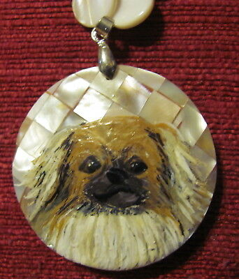 Tibetan Spaniel hand-painted on round, inlaid Mother of Pearl pendant/bead/neckl