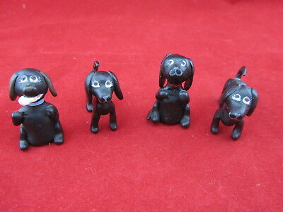 is 4 Vintage American Folk Art Dachshund Dogs Carved & Hand Painted & Signed