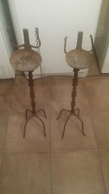 Two antique iron oil lamps of the Bambara people from Mali