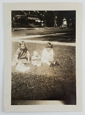 Snapshot Photograph Two Girls Sitting Outside with Dolls 1928