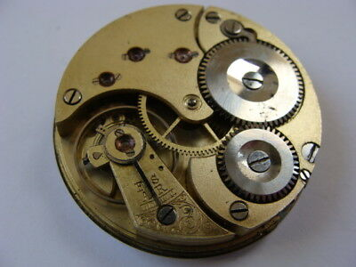Vintage C1910 Omega pocket watch movement for spares repair parts.