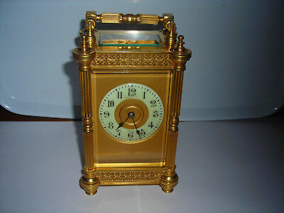 c.1890 BRASS FRENCH 8 DAY CARRIAGE CLOCK. ARABIC NUMERALS+PORCELAIN CHAPTER RING