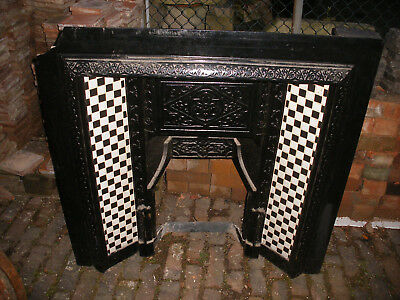 Reclaimed Victorian cast iron black and white tiled fireplace