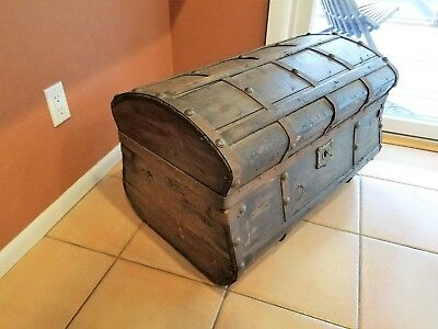 unusual shaped antique trunk from 1850's with beautiful key & Brass decor