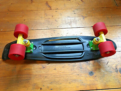 Penny Skateboard Rasta 22, Black deck, Green & Yellow trucks, Red wheels