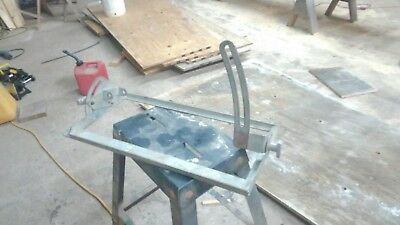 """Swing table for Makita 16"""" beam saw for production cutting of rafter seat cuts."""