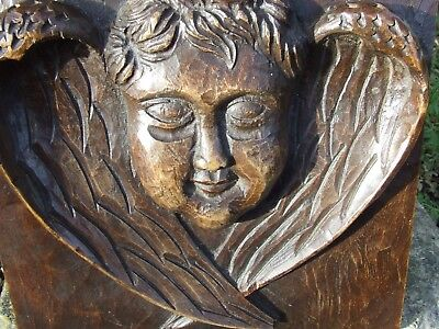 An old carved angel wooden panel