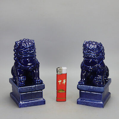 A pair China old hand-carved porcelain blue glaze money drawing lion statue e02