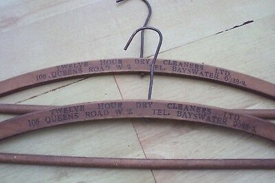 Pair Of Genuine Antique Hand Made Wooden Clothes Hanger With Writing On Them.