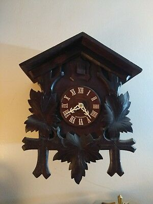 Vintage black forest cuckoo clock converted to quartz battery movement