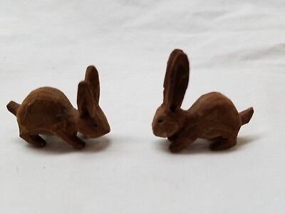 Hand carved wooden rabbits.