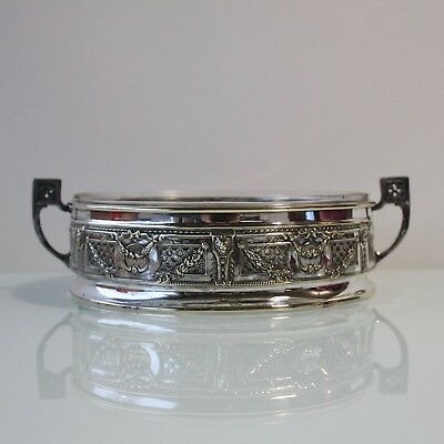 Antique silver plated centerpiece with glass insert.