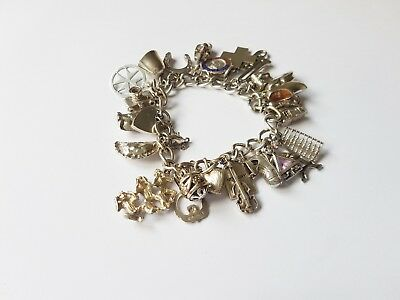 Beautiful Solid sterling silver charm bracelet 25 charms rare, open 69 grams