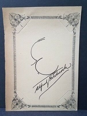 ALFRED HITCHCOCK – Signed autographed self-portrait head sketch on album page