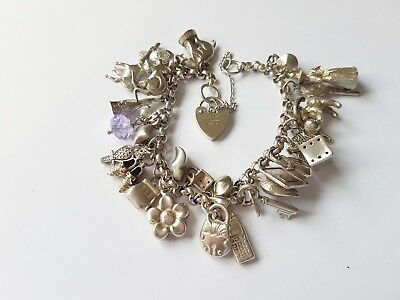 Lovely silver charm bracelet with 29 fab charms 57 grams