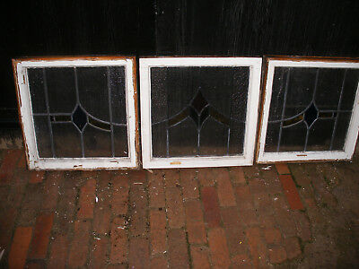 Sets of 1930s stained glass panels with geometric design in wooden frames