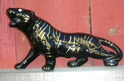 kitschy 1950s black jaguar with gold tiger stripes and rhinestone eyes