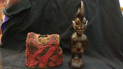 African Wooden Statue with beaded tunic. 11 inches