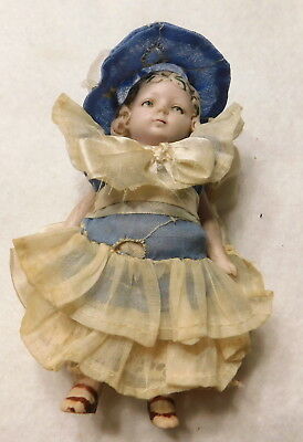 "Antique German Hertwig 4 1/4""  All Bisque Doll & lot of Clothing"