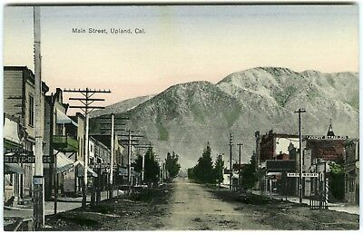 c.1910 UPLAND CALIFORNIA MAIN STREET w/NEWS DEPOT,LIVERY STABLES~UNUSED POSTCARD