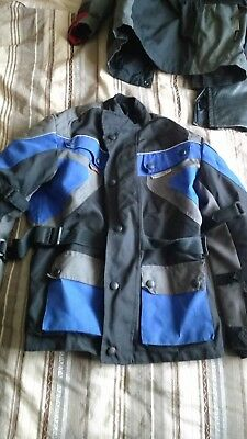 Boys size medium motorcycle jacket with body armour