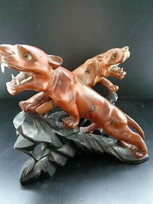 STUNNING EARLY 20th CENTURY CARVED WOOD CHINESE TIGERS ON EBONIZED BASES