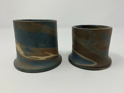 Two Niloak Match Holders with First Art Mark in use from September 1910 to 1924
