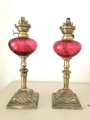 pair of antique cranberry swirl wrythen small oil lamps candlestick