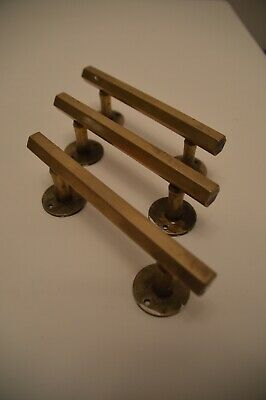 Three vintage solid brass Art Deco pull door handles in hexagonal section
