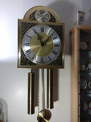 Weight driven wall clock German,   ting tang chime. 33x25cm dial. Good working