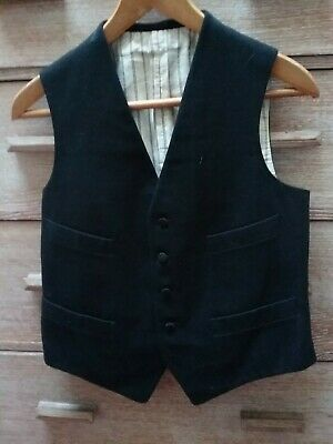 Vintage black wool waistcoat with silk buttons. Probably 1930s or 40s.